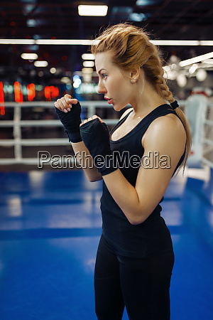woman in black boxing bandages on