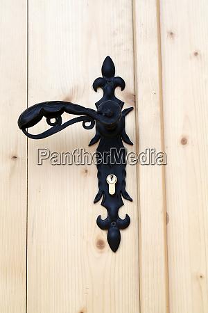 decorative door handle on wooden