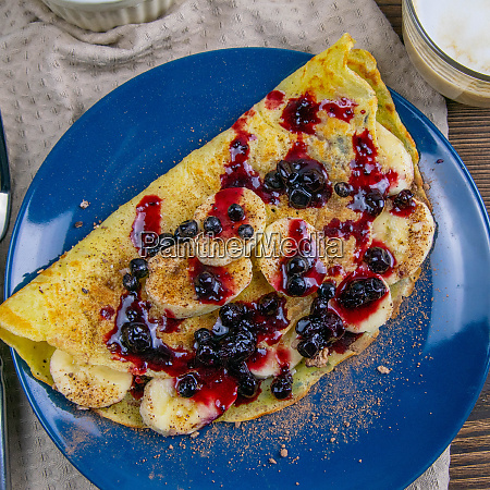 tasty pancakes with bananas blueberries and