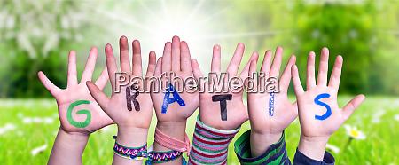 children hands building word gratis means