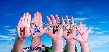 children hands building word happy blue