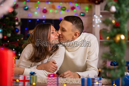heterosexual couple hugs in a decorated
