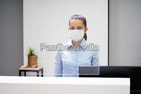 receptionist woman at office reception