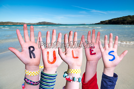 children hands building word rules ocean
