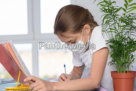 a sick girl teaches homework and