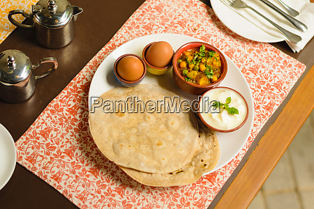traditional nepali indian breakfast with hard