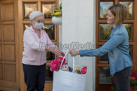 senior woman with protective mask gets