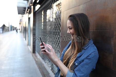 happy girl checks smart phone in
