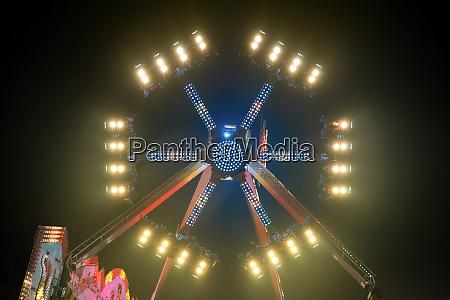 a large night funfair ride carousel