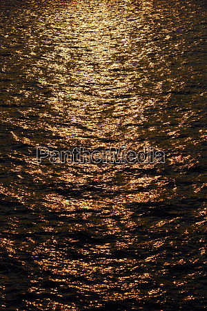 sunset reflected in sea level
