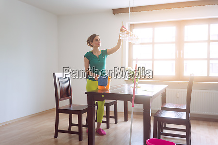 housewife dusting during spring cleaning