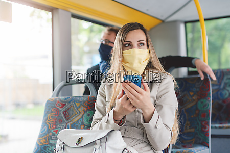 people wearing masks in the bus