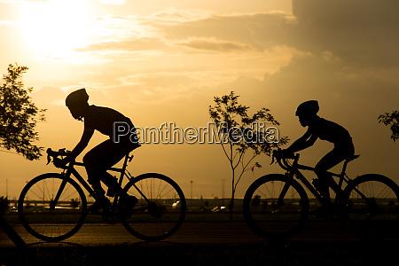 silhouette bike on sunset