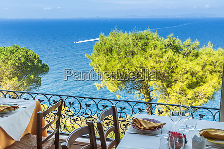 restaurant table overlooking the sea on