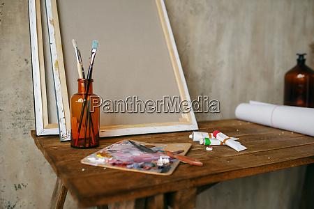 paints on palette brush in bottle