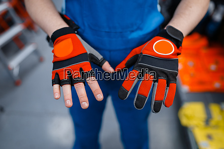 male worker hands in protective gloves