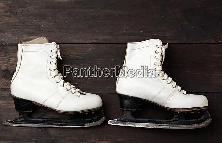 pair of white leather skates for