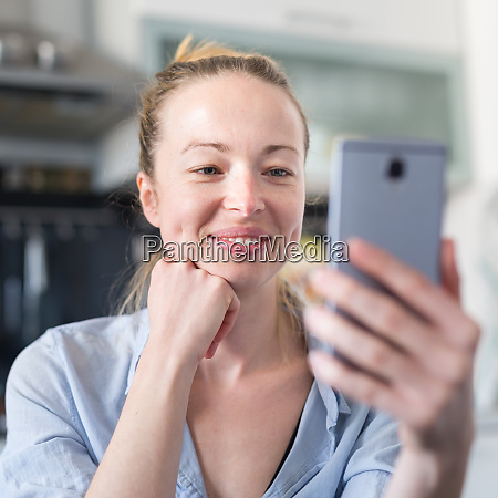 young smiling cheerful pleased woman indoors