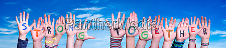 children hands building word strong together