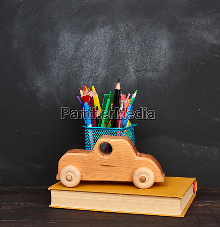 wooden toy book multicolored pens and