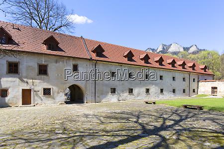 14th century red monastery courtyard surrounding