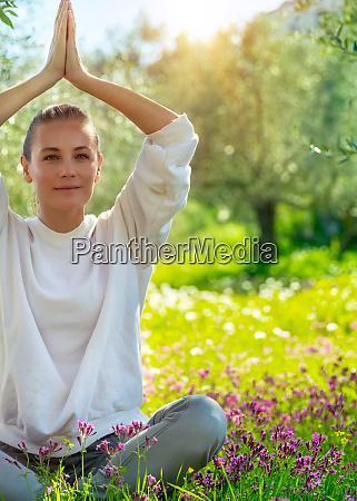pretty girl doing yoga outdoor