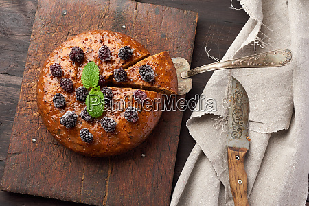 baked round biscuit cake with nuts