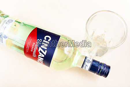 glass with vermouth and bottle of