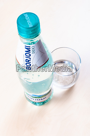 bottle of borjomi and glass with