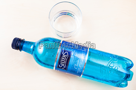 lying plastic bottle of selters and