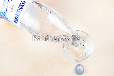 pouring of gerolsteiner water from bottle