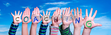 children hands building word coaching blue