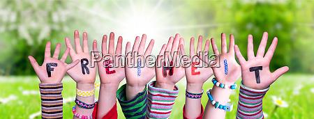 children hands building word freiheit means