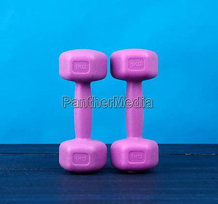 pink plastic dumbbells of one kilogram