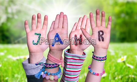 children hands building word jahr means
