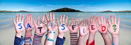 children hands building word satisfied ocean