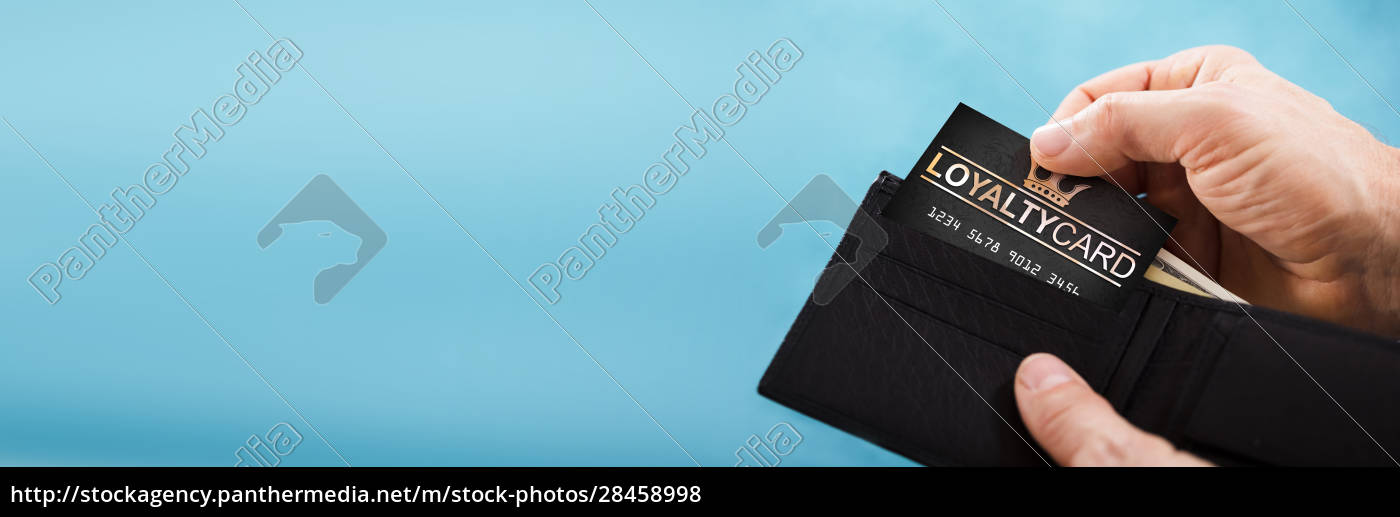 person, removing, loyalty, card, from, wallet - 28458998
