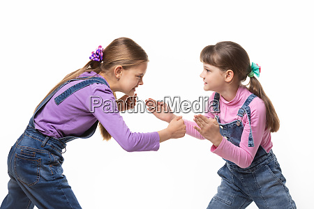 two girls quarrel and fight with
