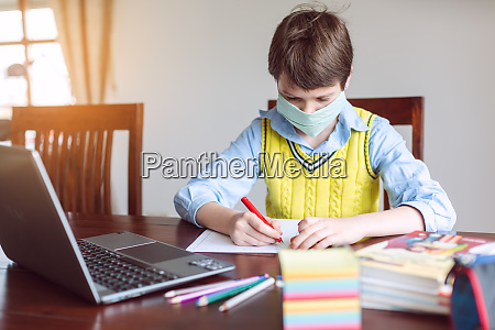 student working from home because school