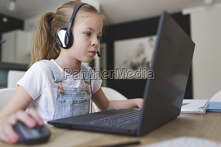 beautiful young girl with headset is