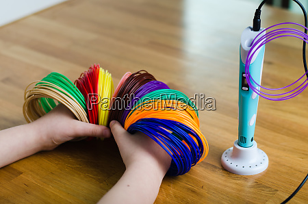 childs hands hold kit colored abs