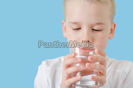 cute child drinking clean water from