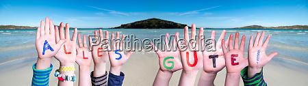 children hands building word alles gute