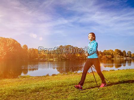 nordic walking woman outdoors