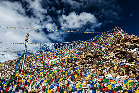 tibetan buddhist prayer flags on top