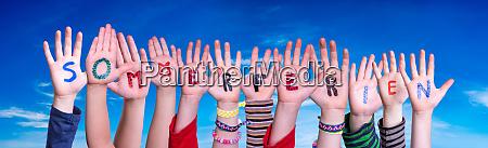 children hands building word sommerferien means