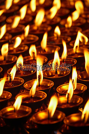 burning candles in buddhist temple dharamsala