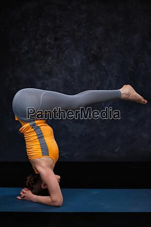 woman doing hatha yoga ashtanga vinyasa