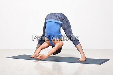 woman practices ashtanga vinyasa yoga asana
