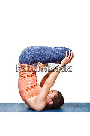 sporty fit yogini woman practices inverted